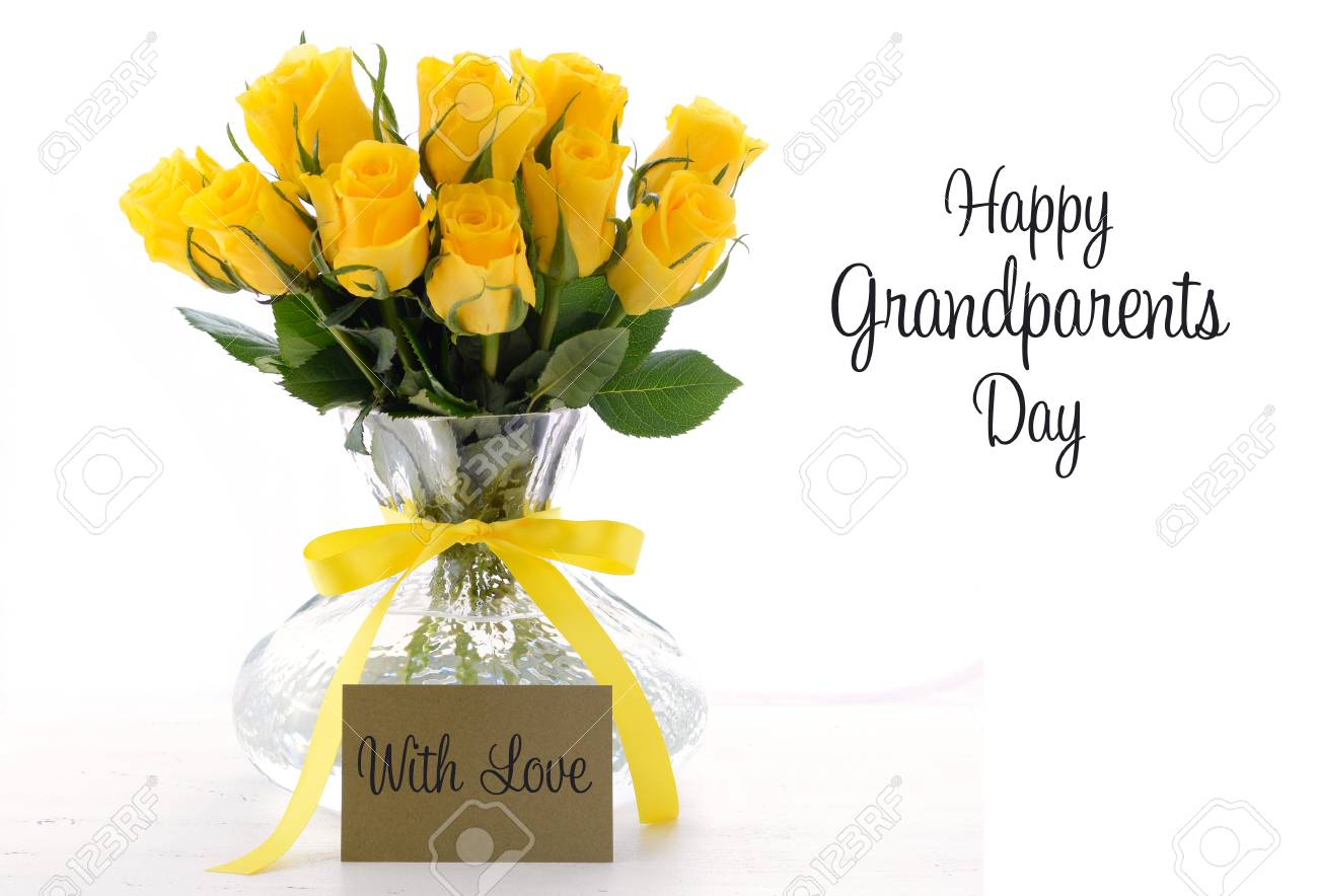 Yellow roses gift in vase with greeting card and sample text stock stock photo yellow roses gift in vase with greeting card and sample text for grandparents day on white vintage wood table m4hsunfo