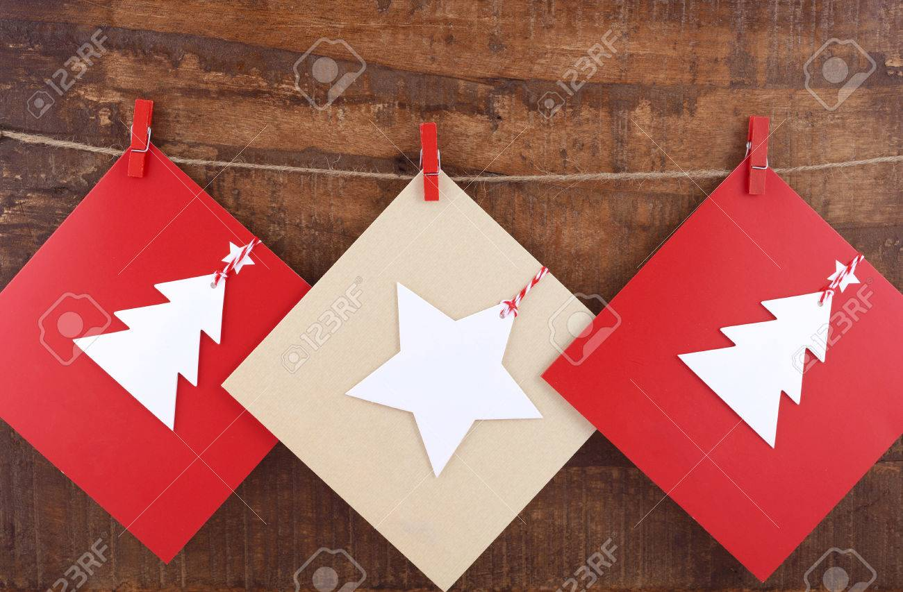 Handmade christmas greeting card using cutout shapes on natural handmade christmas greeting card using cutout shapes on natural kraft paper hanging from pegs on string m4hsunfo