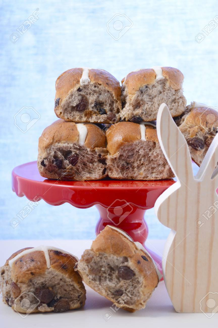Happy Easter Hot Cross Buns On Red Cake Stand And Wooden Bunny
