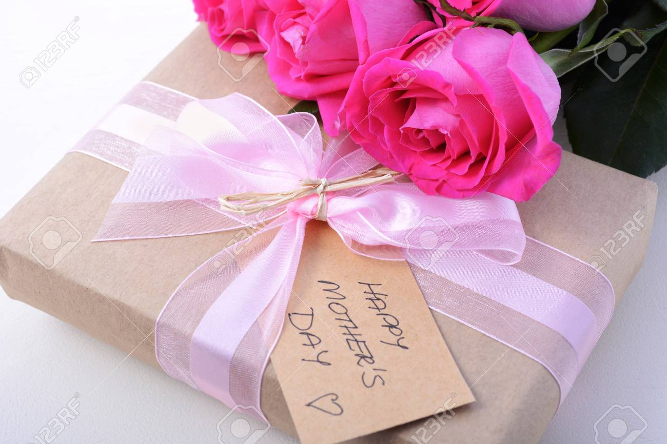 Happy Mothers Day Brown Paper Gift And Pink Roses On White Wood ...