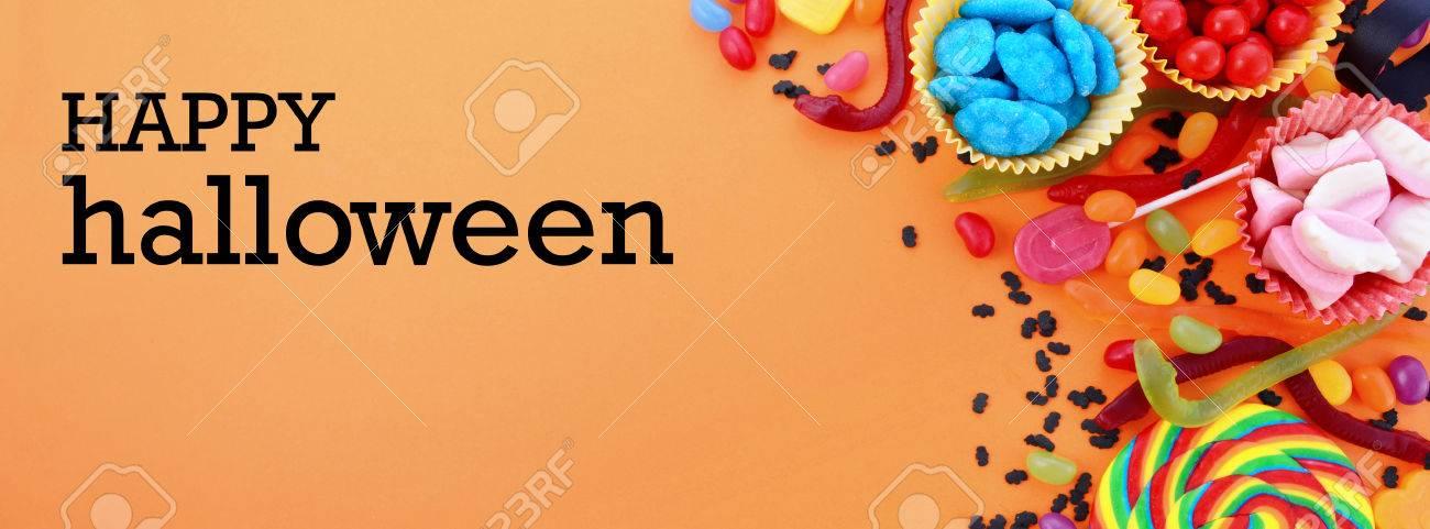 foto de archivo halloween o de cumpleaos de los nios favores de caramelo en un fondo de color naranja brillante de tamao para adaptarse a un popular