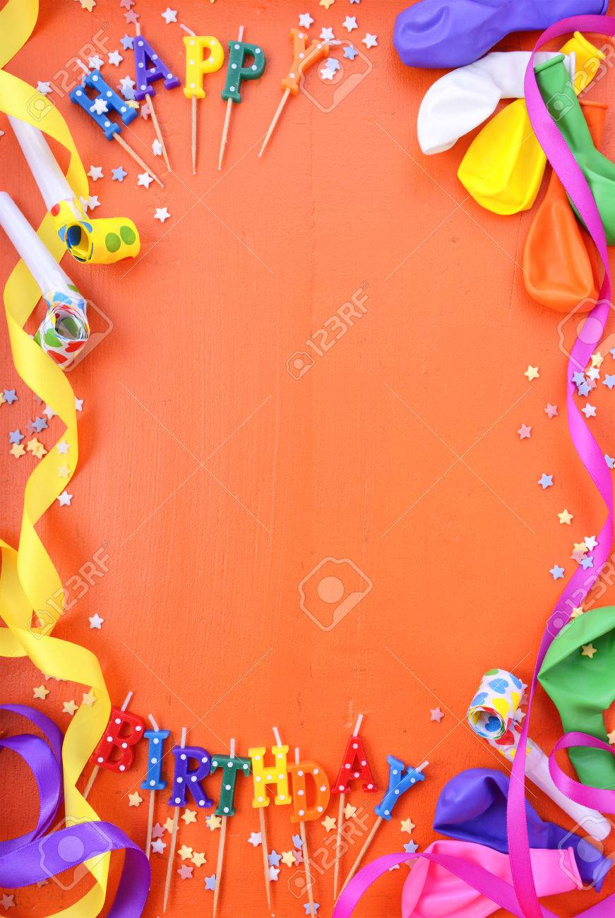 Happy Birthday Background With Decorated Borders Party Decorations On A Bright Orange Wood Table