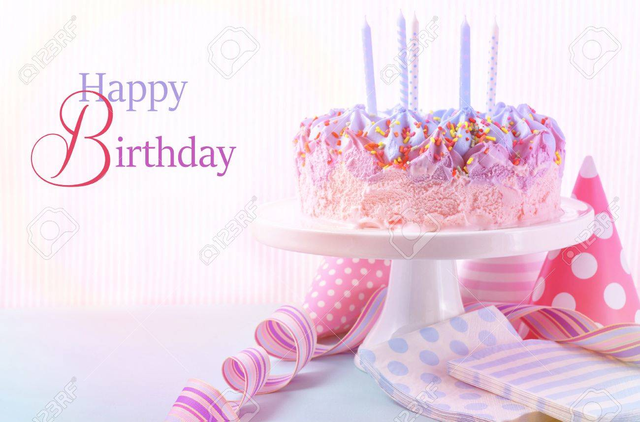 Childrens Pink And Blue Ice Cream Birthday Cake With Candles Stock