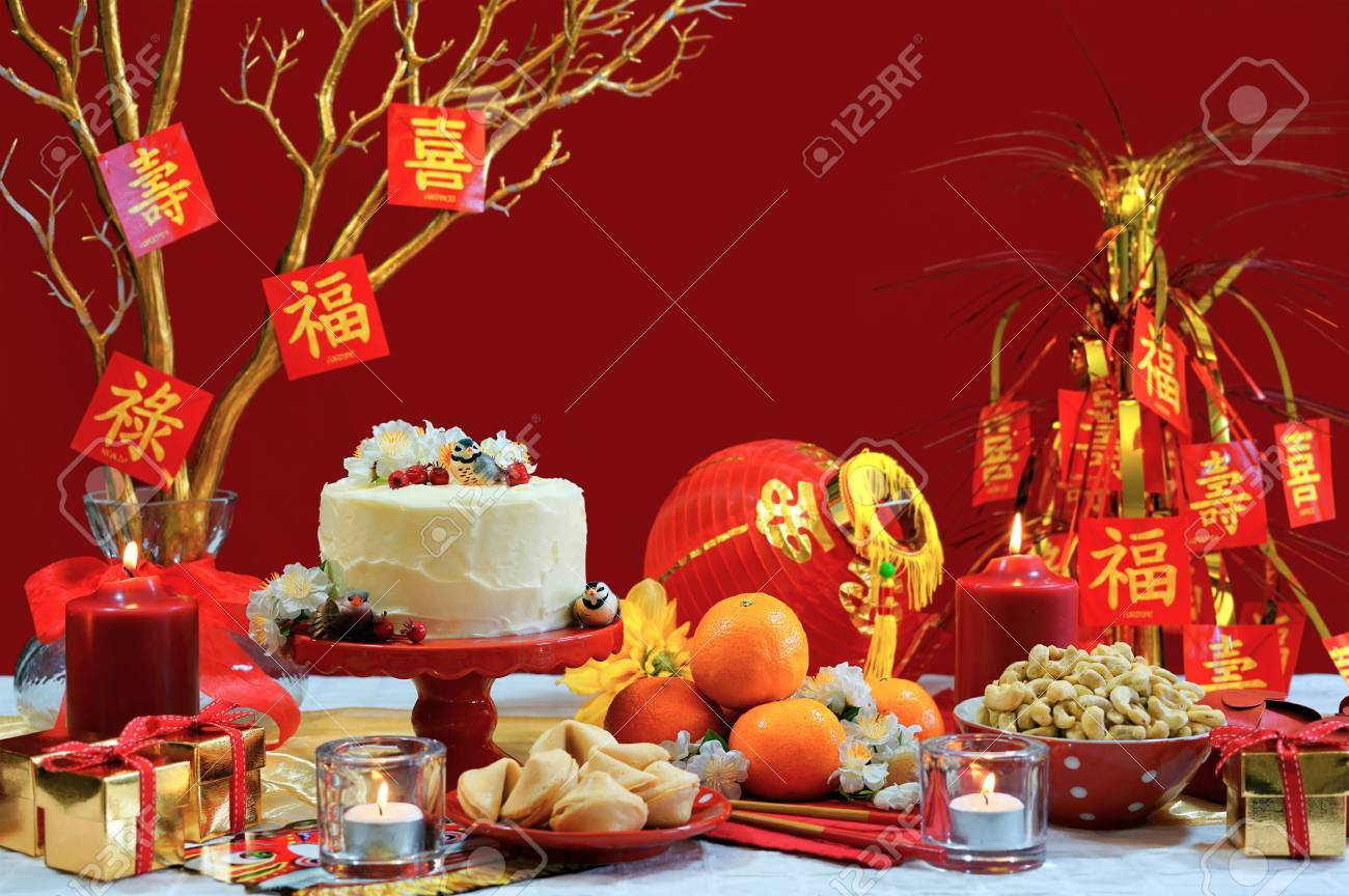 chinese new year party table in red and gold theme with food stock