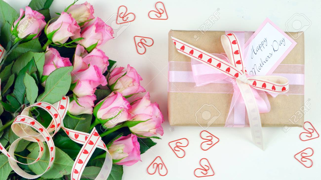 Happy Mothers Day Overhead With Gift And Pink Roses On White.. Stock ...