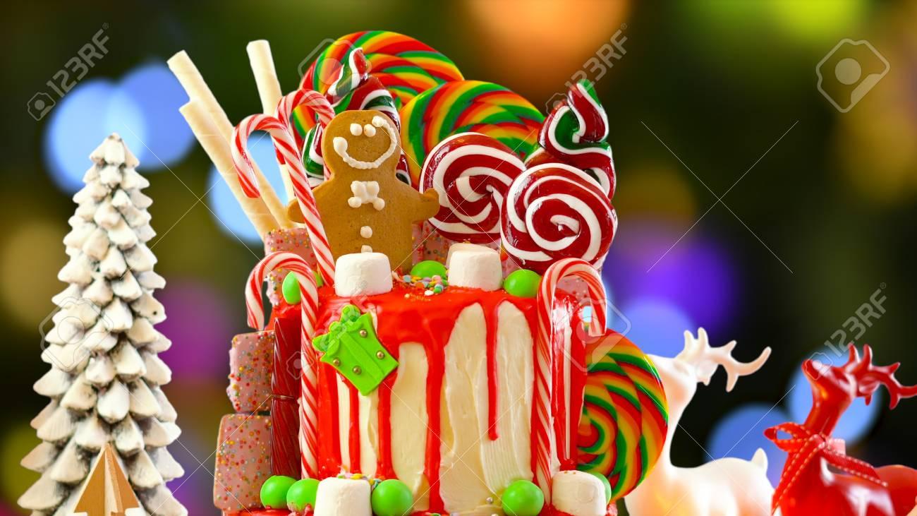 Christmas Candyland Backdrop.On Trend Festive Candyland Christmas Drip Cake Against Festive