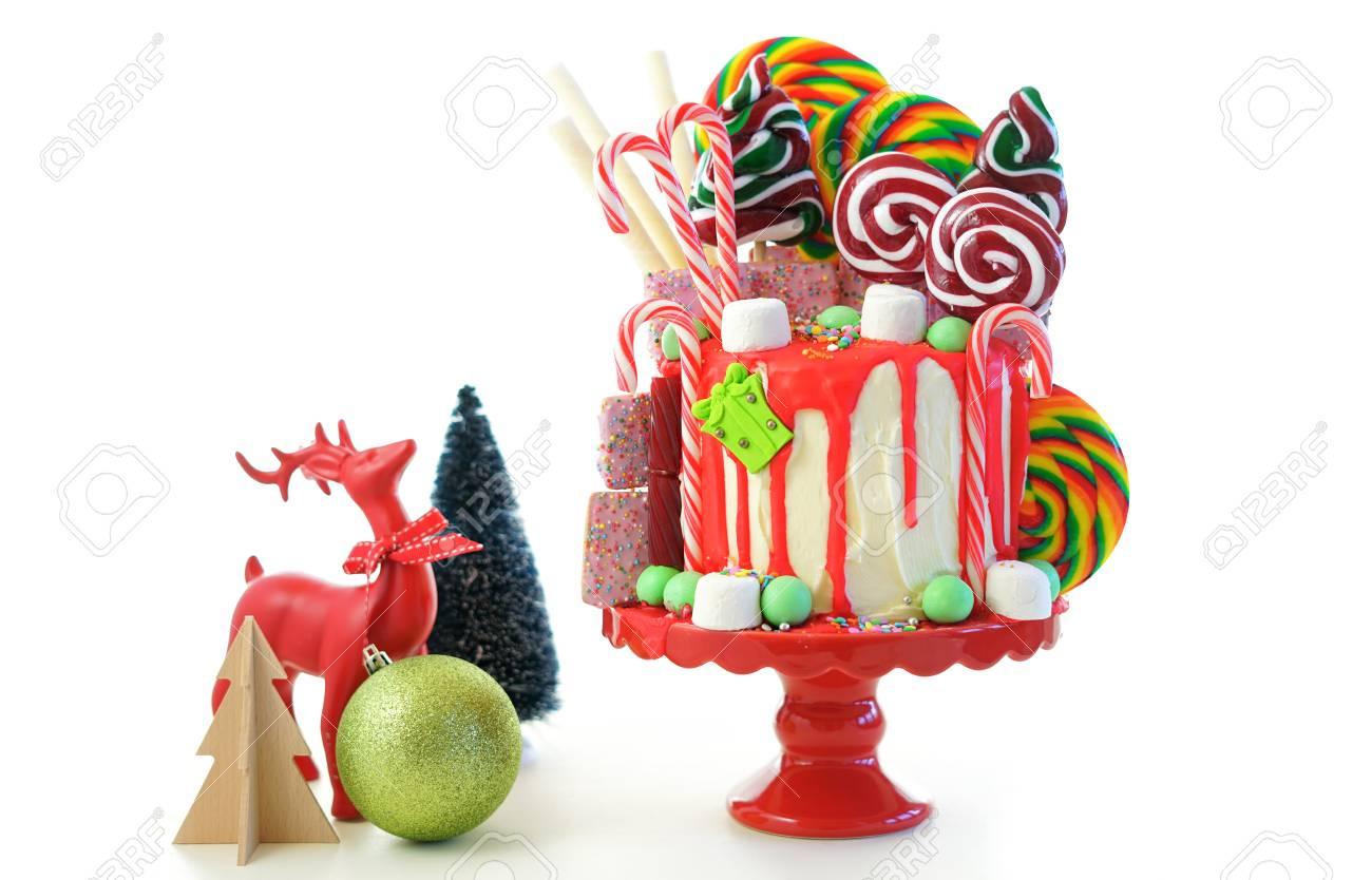 Christmas Candyland Backdrop.On Trend Festive Candyland Christmas Drip Cake On White Background