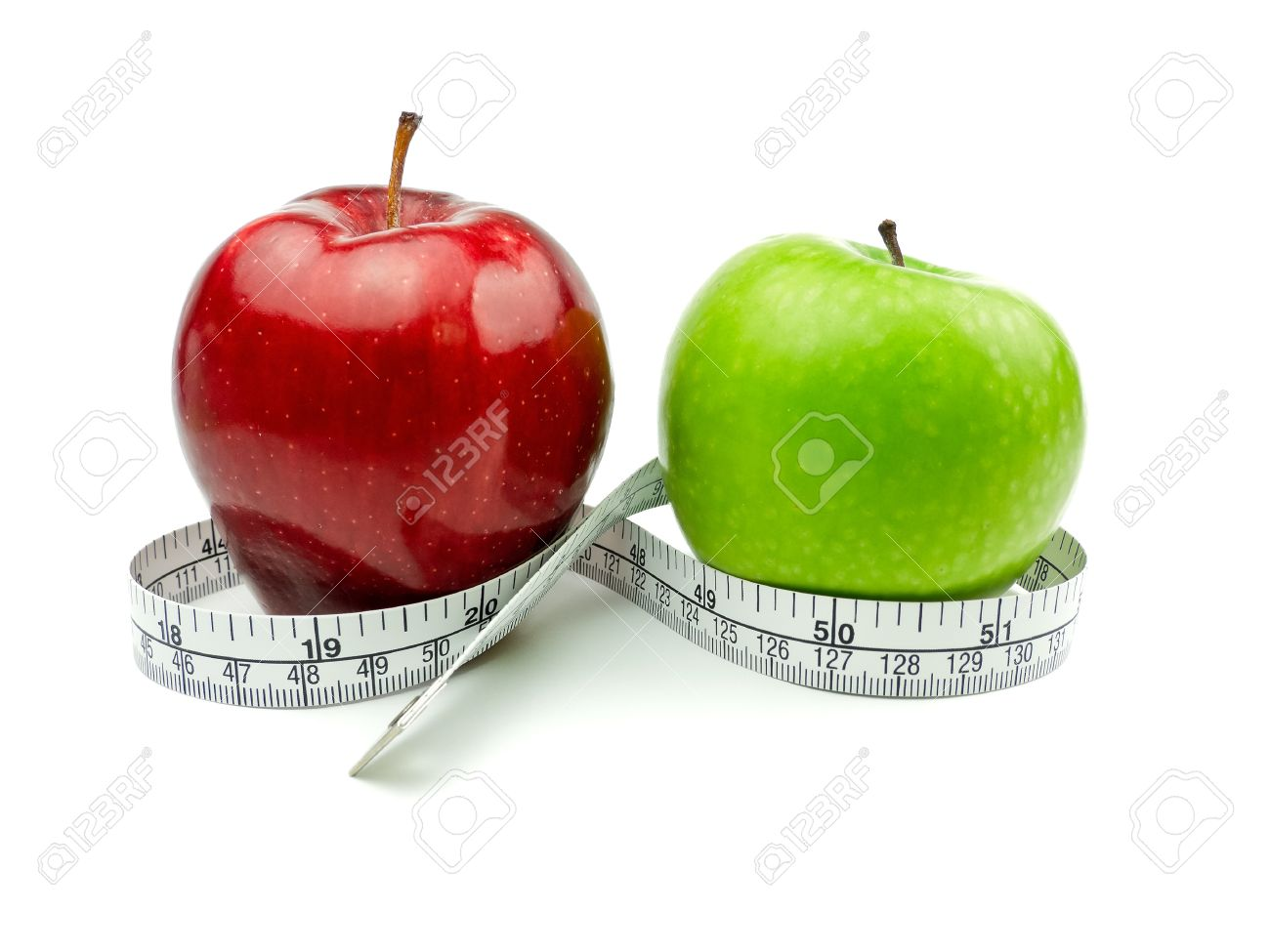 Green Apple and Red Apple with measuring tape on white background Stock Photo - 12432419
