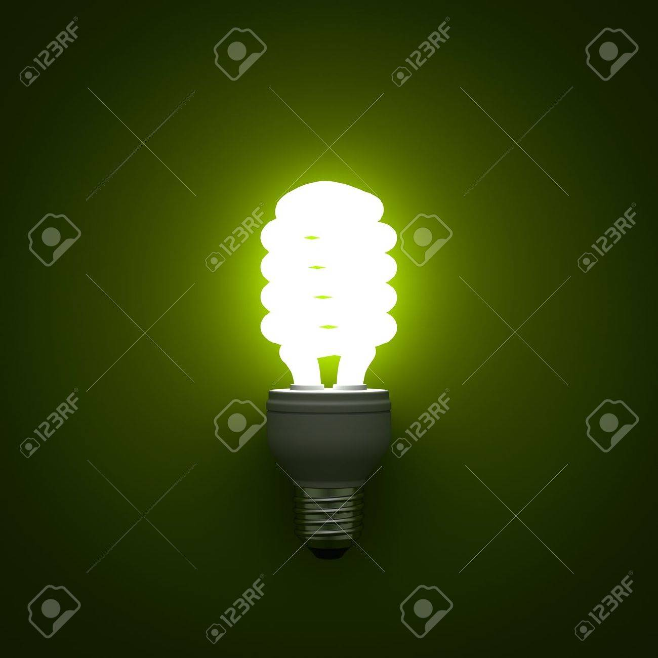 cfl energy saving compact fluorescent light bulb glowing on green background - Compact Fluorescent Light Bulbs