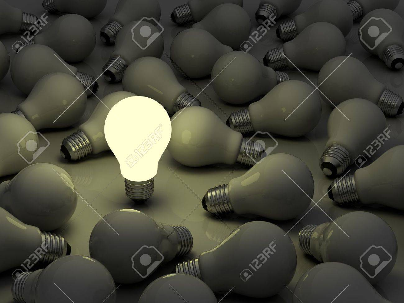 One glowing light bulb standing out from the unlit incandescent bulbs - 14821616