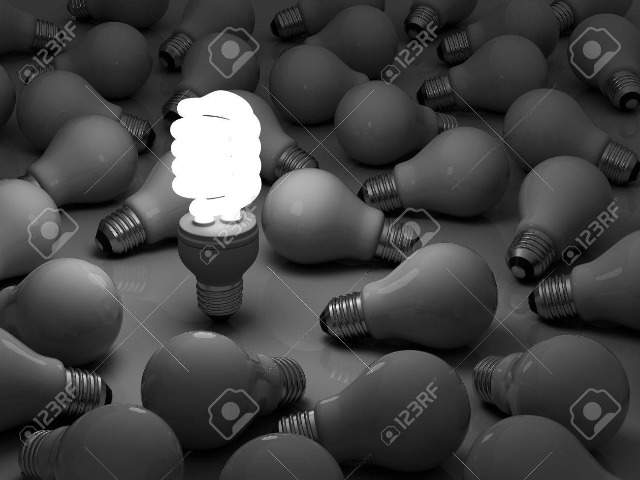 It s time for energy saving light bulb, one glowing compact fluorescent light bulb standing out from the unlit incandescent bulbs Stock Photo - 14821614