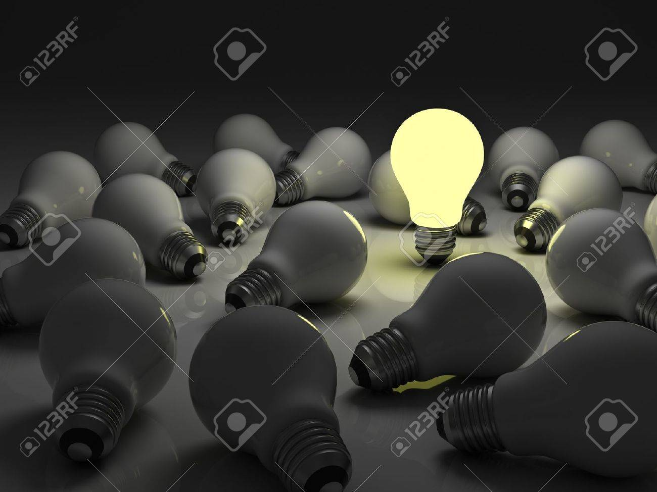 One glowing light bulb standing out from the unlit incandescent bulbs with reflection , The business concept and individuality concept Stock Photo - 15710564
