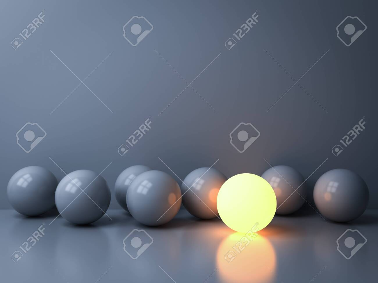 Stand out from the crowd and Leadership creative idea concepts One luminous sphere shining among other dim spheres on white background in the dark with reflections and shadows 3D rendering - 123201797