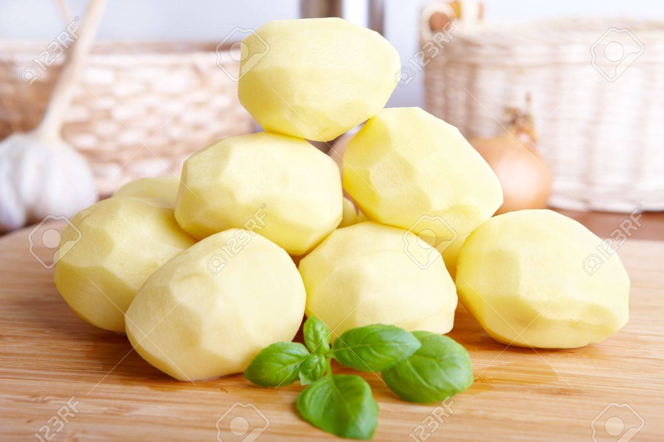 Pile of fresh potatoes with green leaves of basil Stock Photo - 8887284