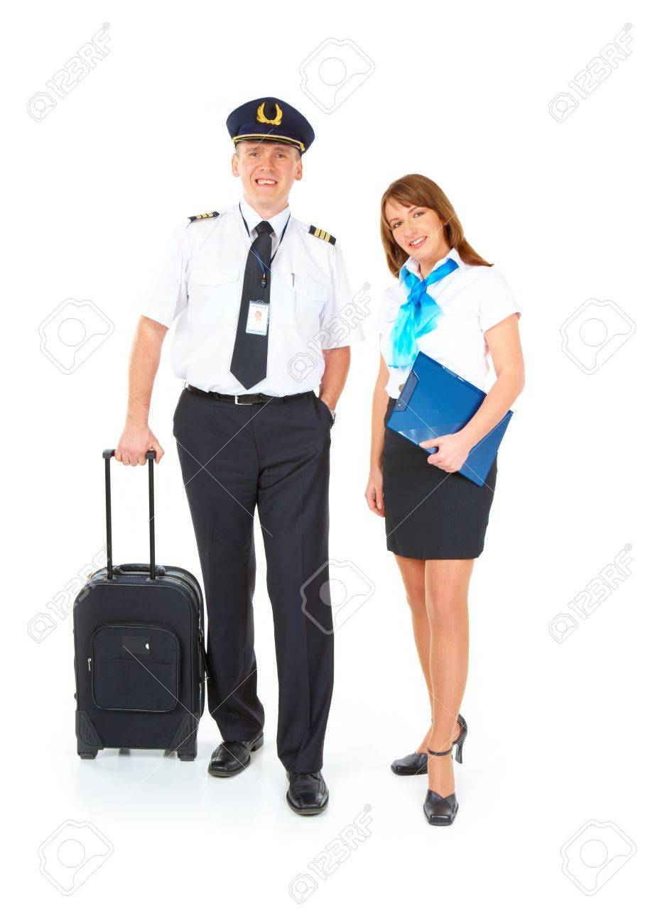 Flight crew. Cheerful pilot with trolley bag in hand and smiling flight attendant with documents wearing uniforms standing, isolated over white background Stock Photo - 8887187