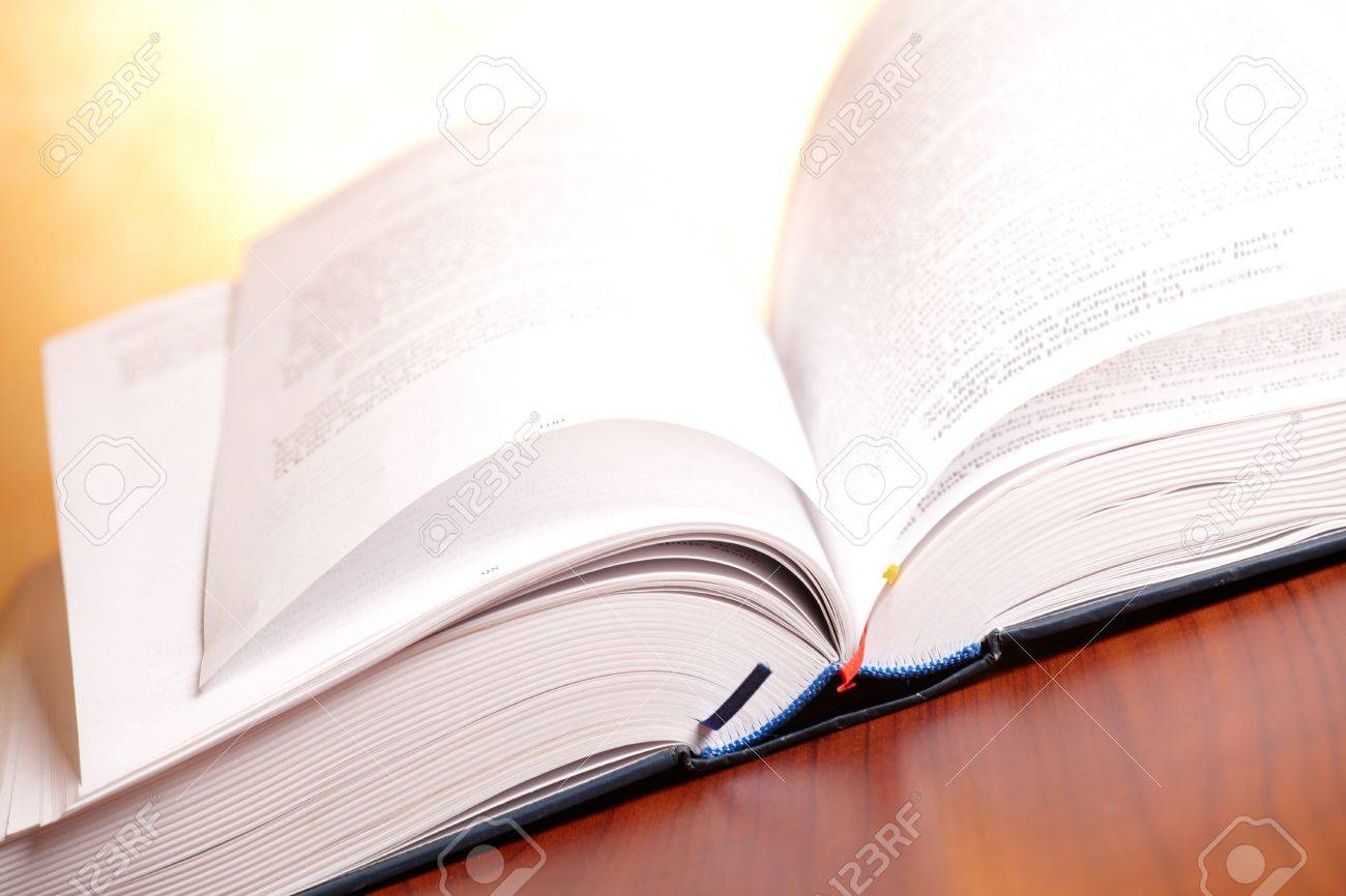 Open book on the wooden table Stock Photo - 12250563