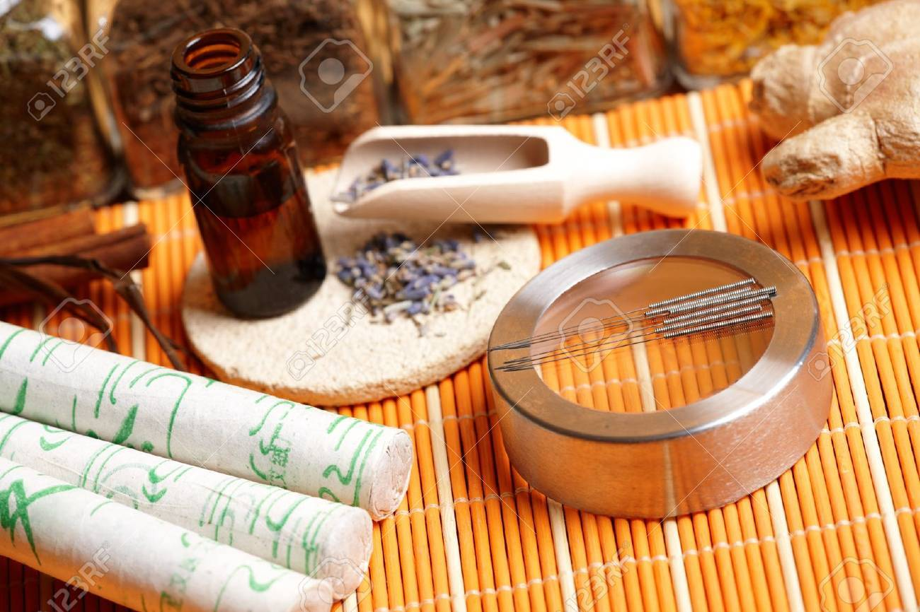 Acupuncture needles, moxa sticks, lavender petals with macerated oil, giner and herbs in jars  TCM Traditional Chinese Medicine concept photo Stock Photo - 13571184