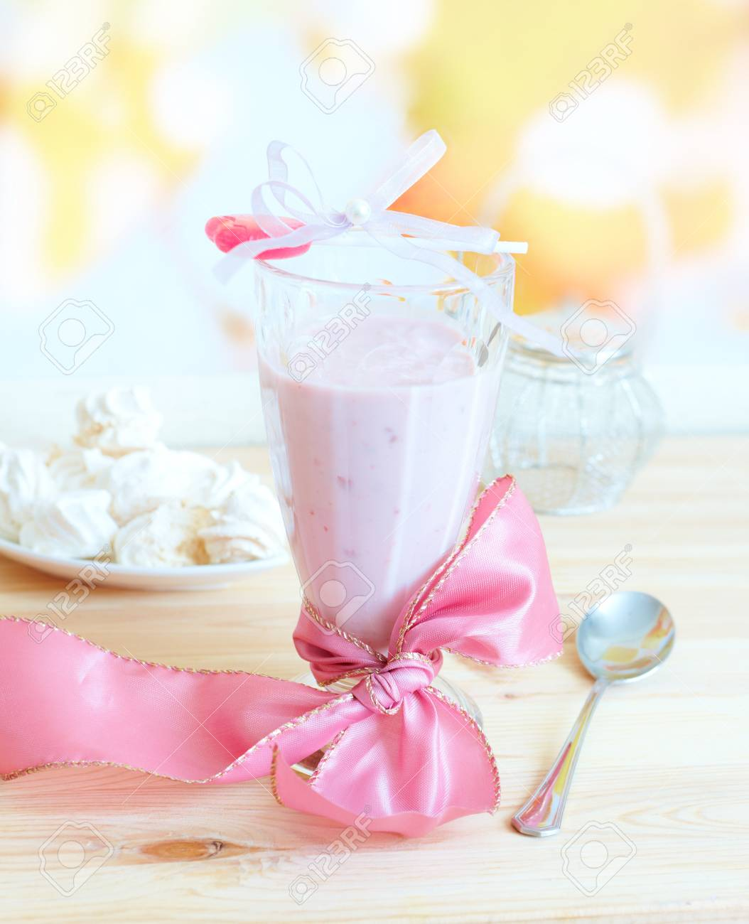 Fresh raspberry smoothie with sweet lollipop and merengues in backckground  Fruit cocktail is a light drink made of milk and raspberries, strawberies and other fruits Stock Photo - 14781175