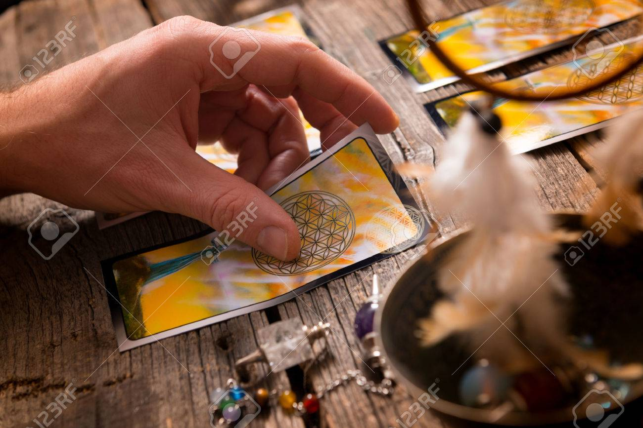 Fortune teller holding a tarot card - 51029175