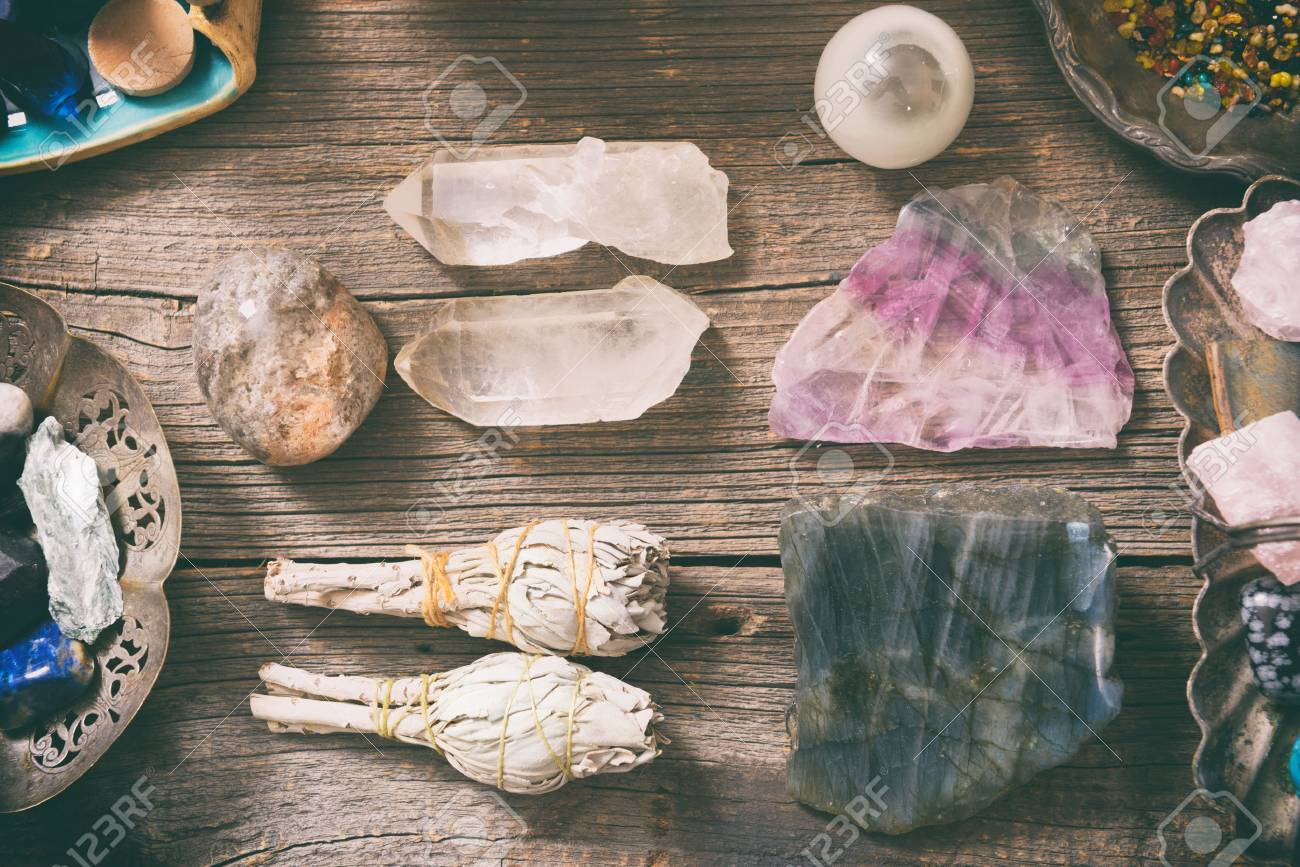Natural gemstones, white sage and incense on wooden board - 73082085