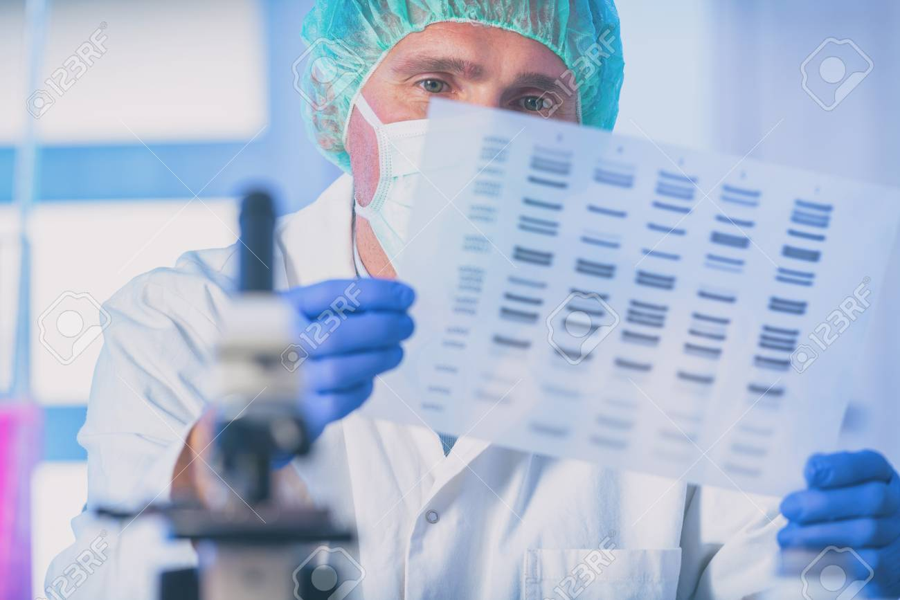 Scientist analizing DNA sequence in the modern laboratory - 121948704