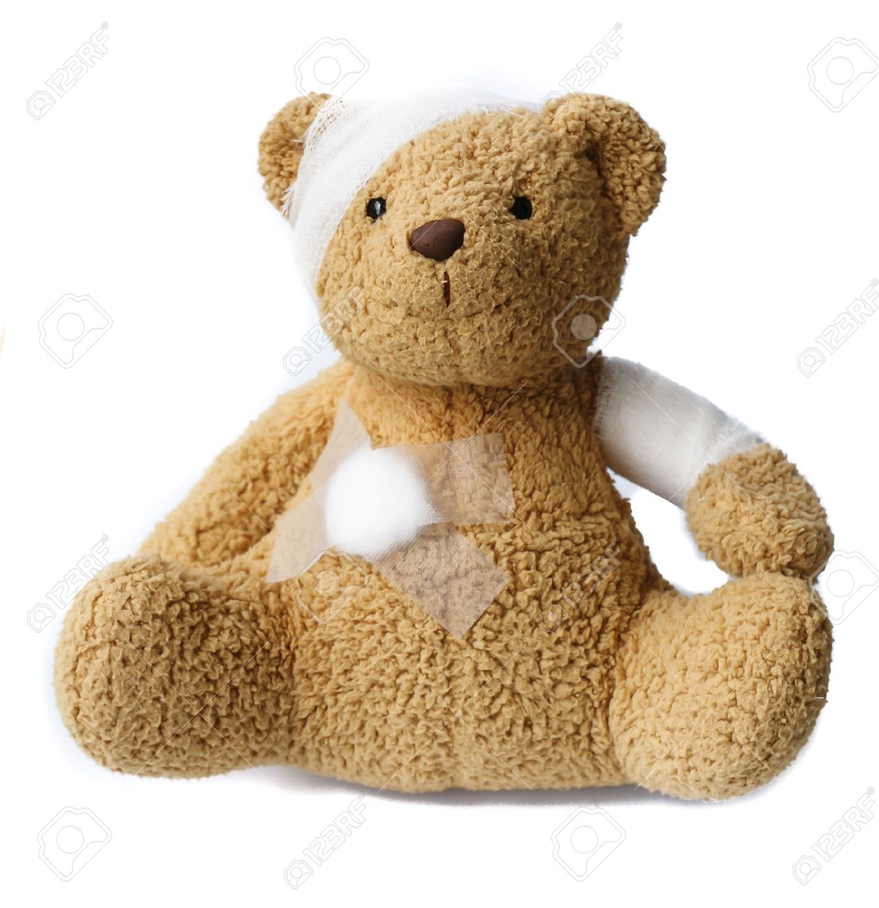 teddy bear with bandaged head on white background Stock Photo - 26667231