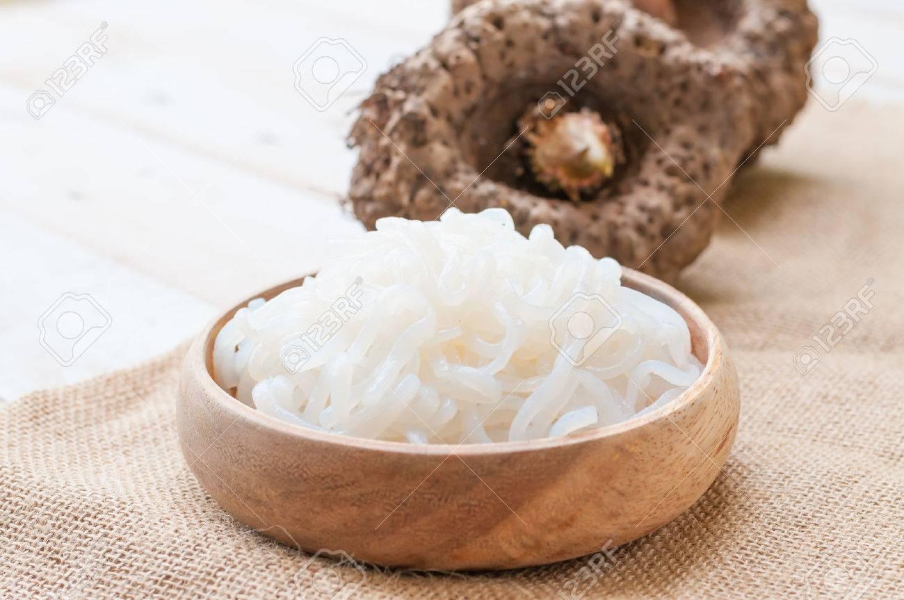 Shirataki noodle, konjac on white wooden board - 43591497