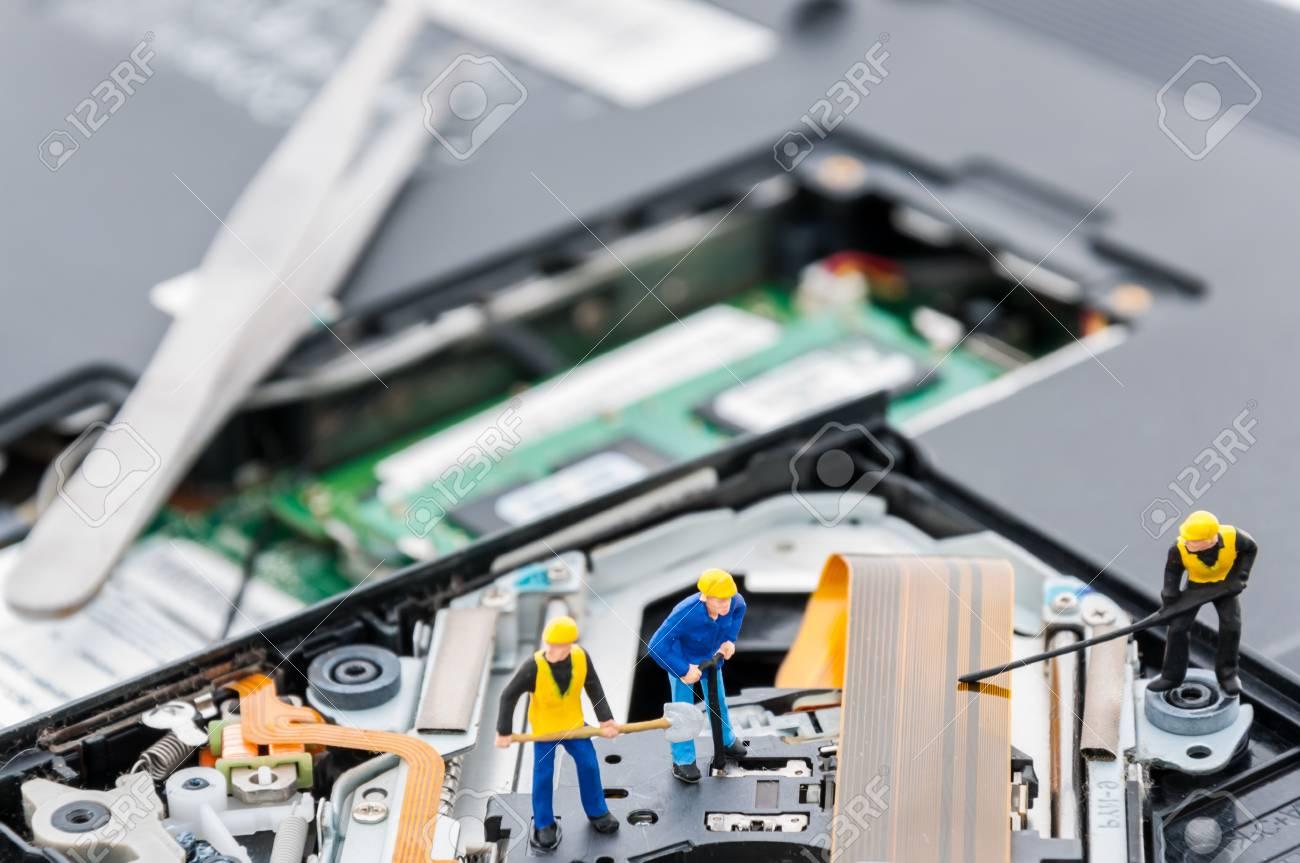 Engineers Fixing Computer Circuit Board Miniature People Stock Engineer Repairing Royalty Free Photo Image 43590530