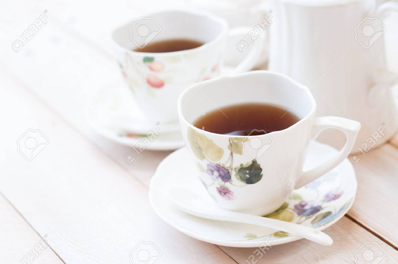 Afternoon tea in cups - 47440769