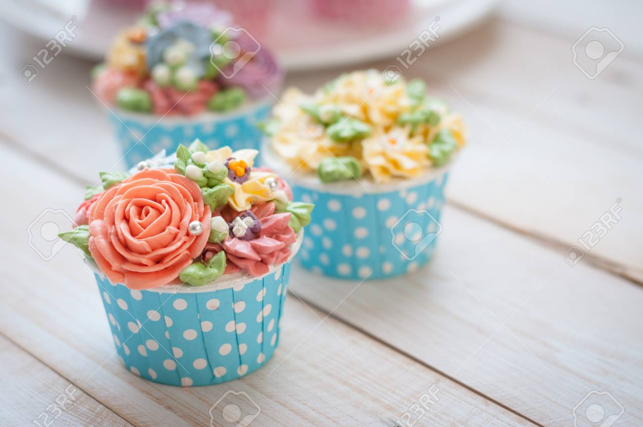 Many Sweet Birthday Cupcakes With Flowers And Butter Cream Stock Photo