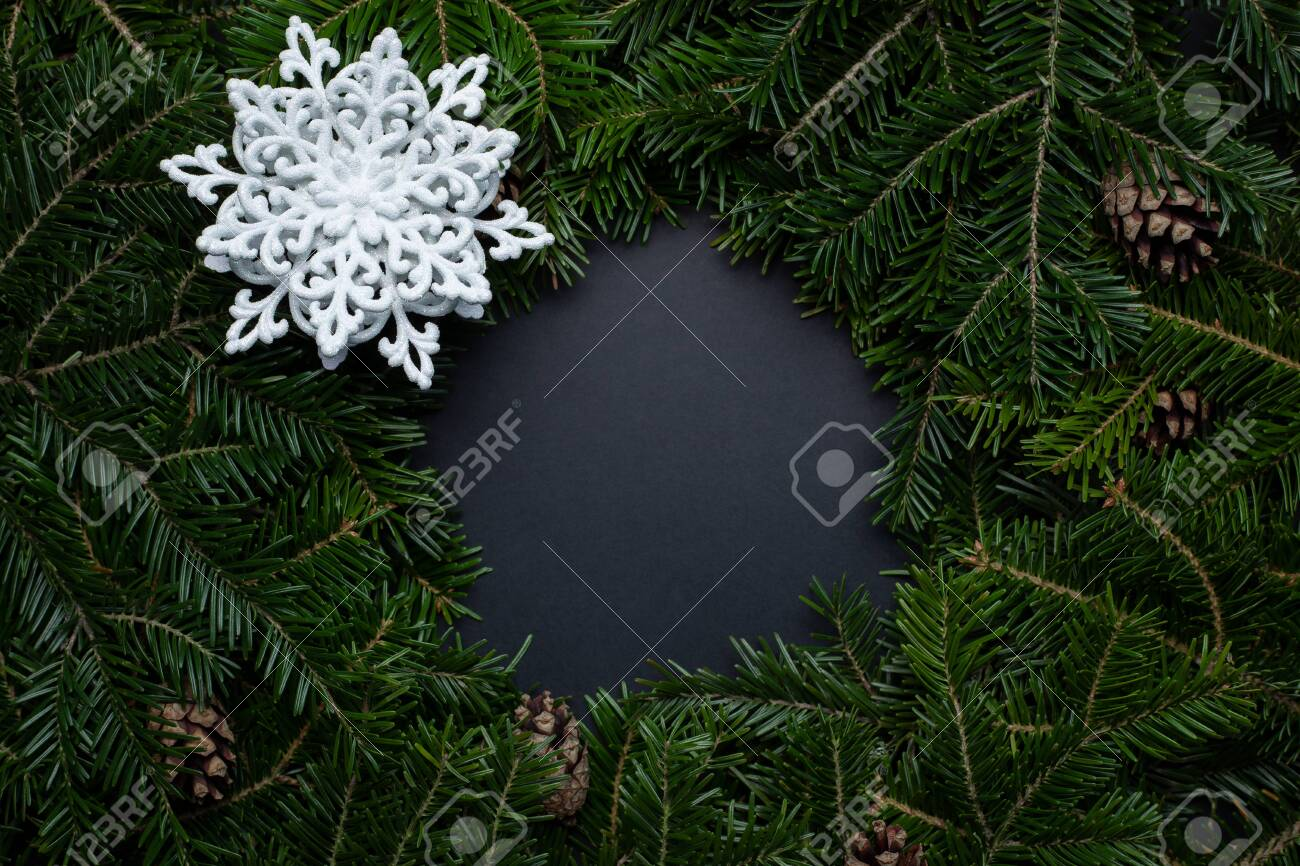 Wreath Of Christmas Tree Branches Decorated With Cones And A Stock Photo Picture And Royalty Free Image Image 139501052