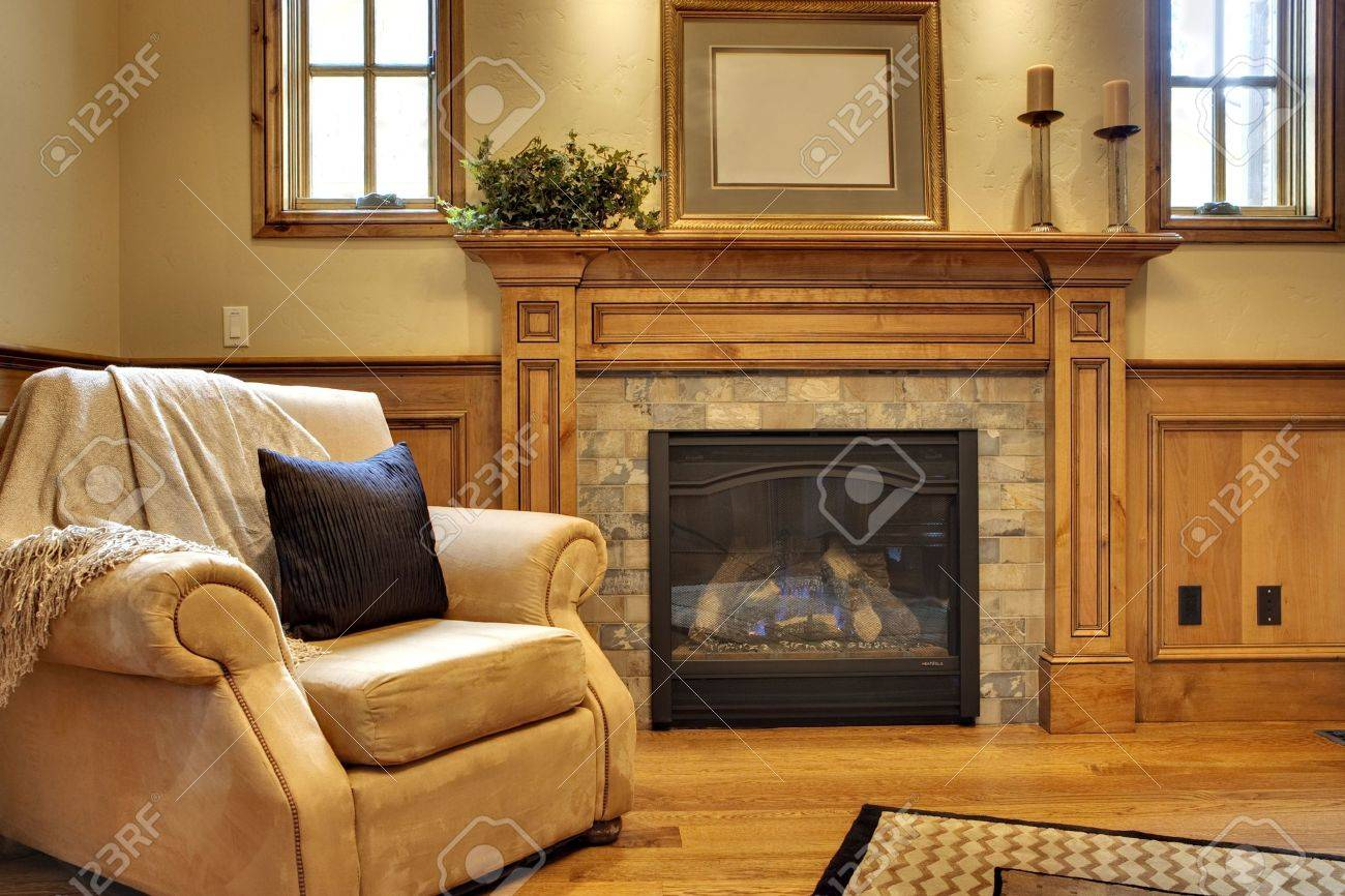 Office With Comfortable Chair And Fireplace Stock Photo, Picture ...