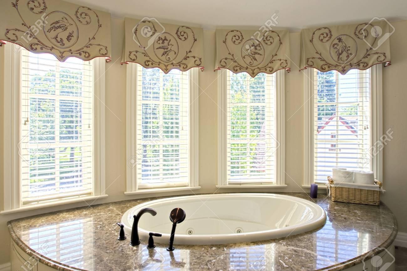 View of elegant bathtub with bright window lighting Stock Photo - 5289924