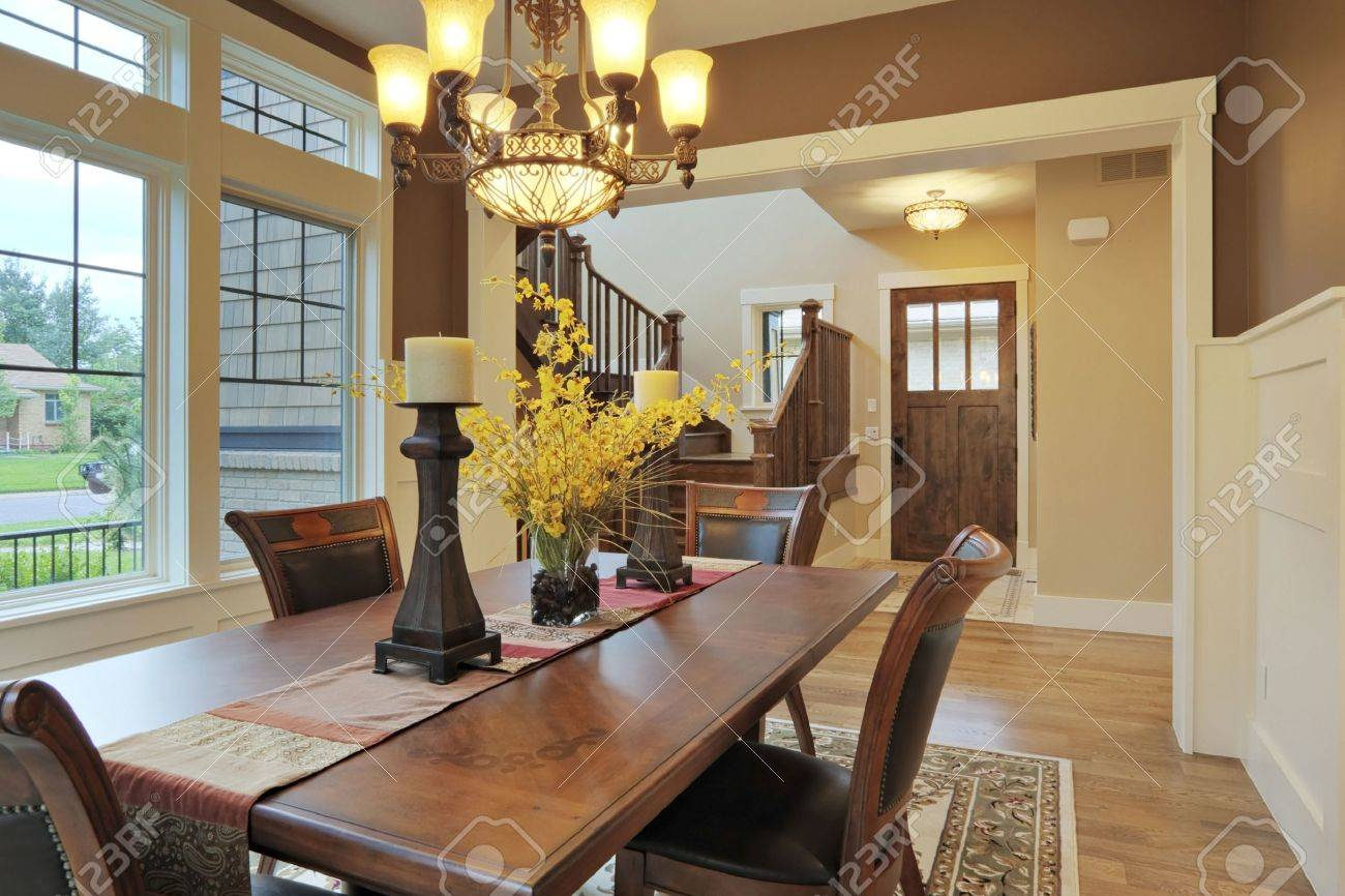Large Dining Room With Wood Floors And Area Rug Stock Photo Picture