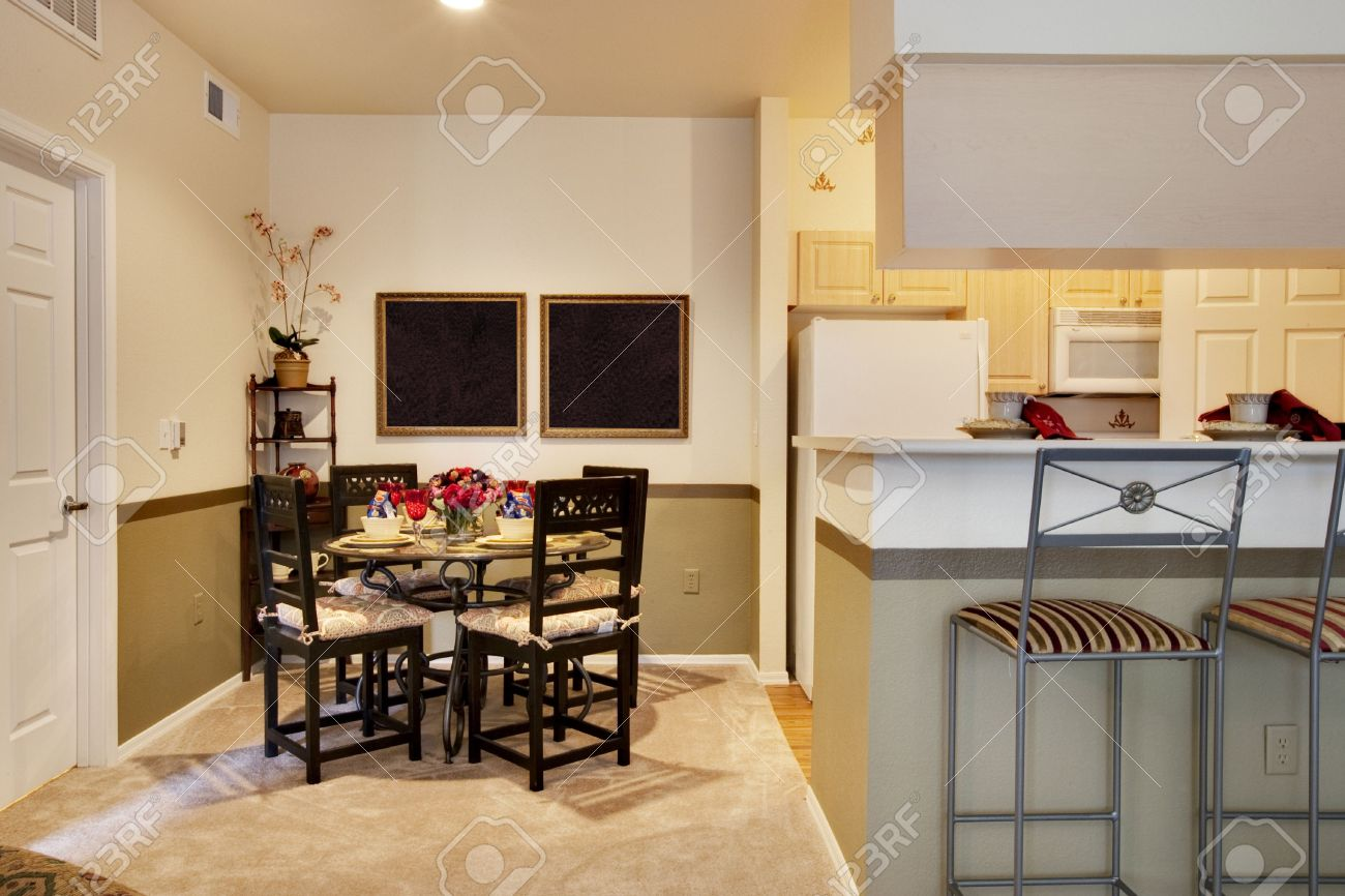 Dining Table Next To Kitchen Area Stock Photo
