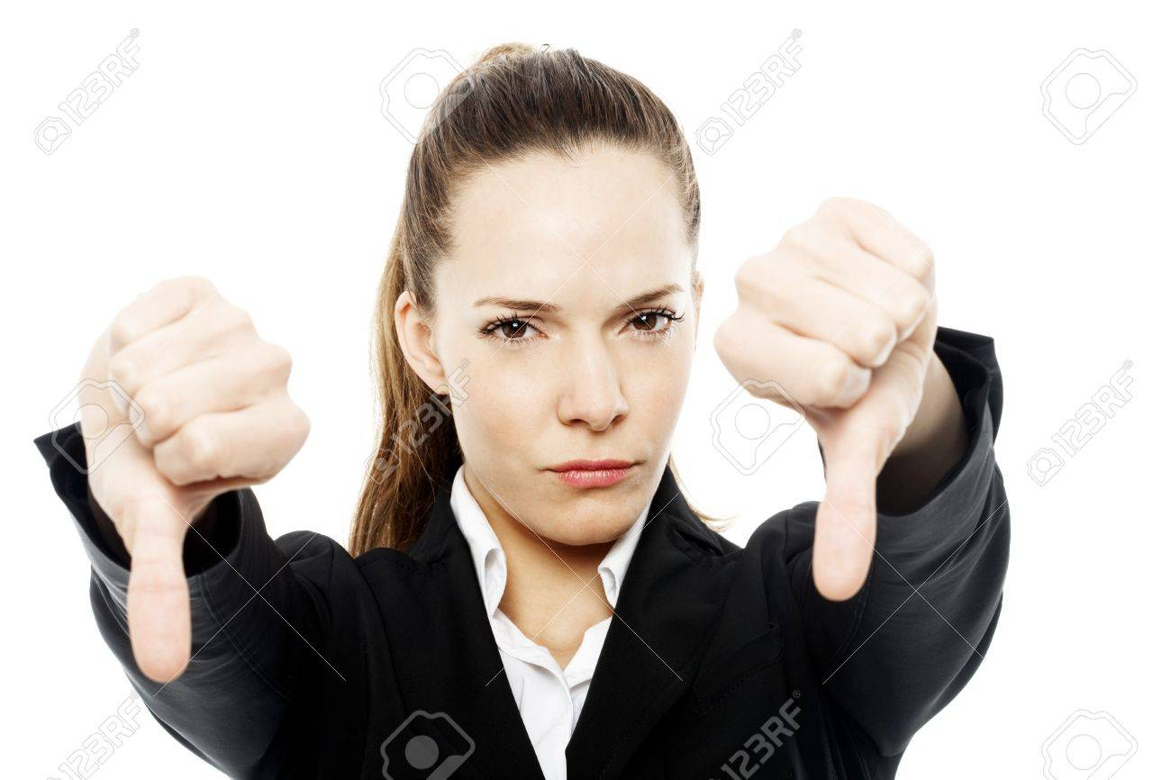 severe businesswoman with thumb down on white background studio Stock Photo - 7645237