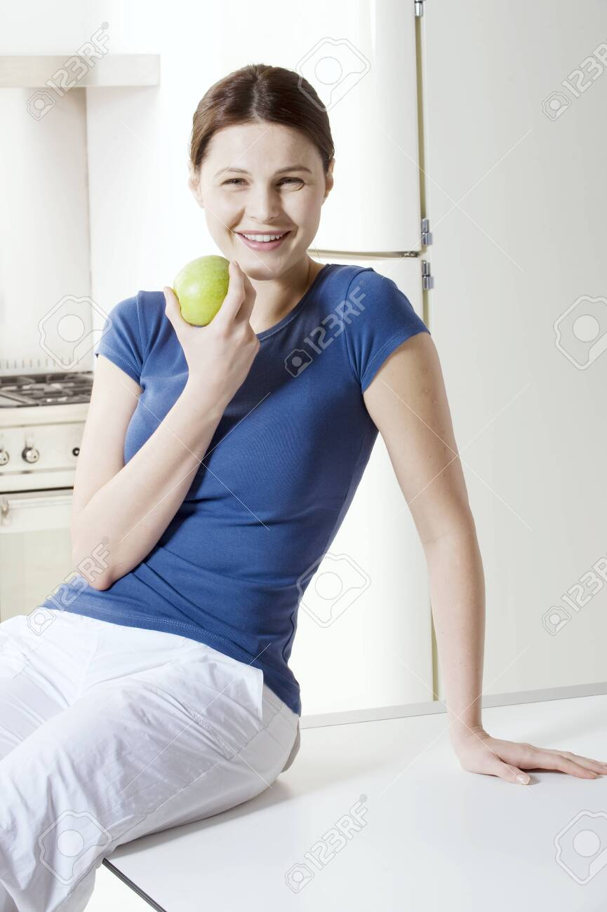 woman eating an apple Stock Photo - 8549690