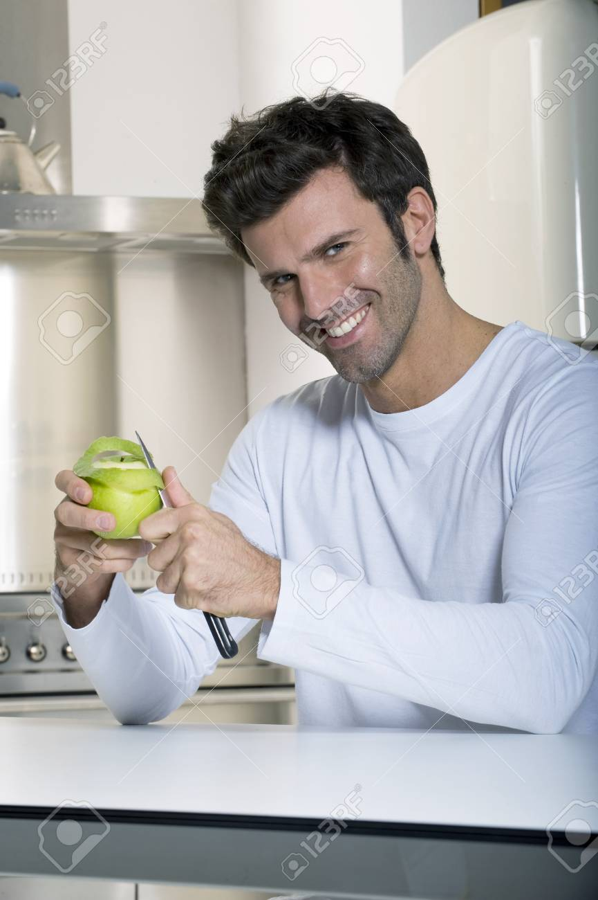 man peeling an apple Stock Photo - 8545221