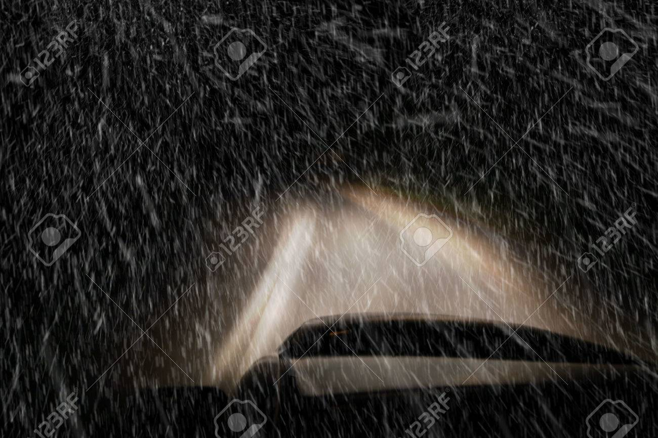 Driving a car at night in a snowstorm - 33984450