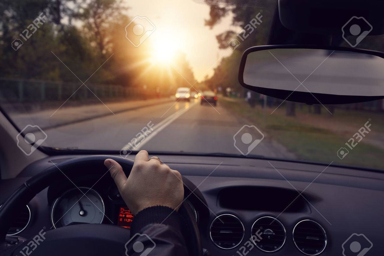 Driving a car on the city streets - 34072909