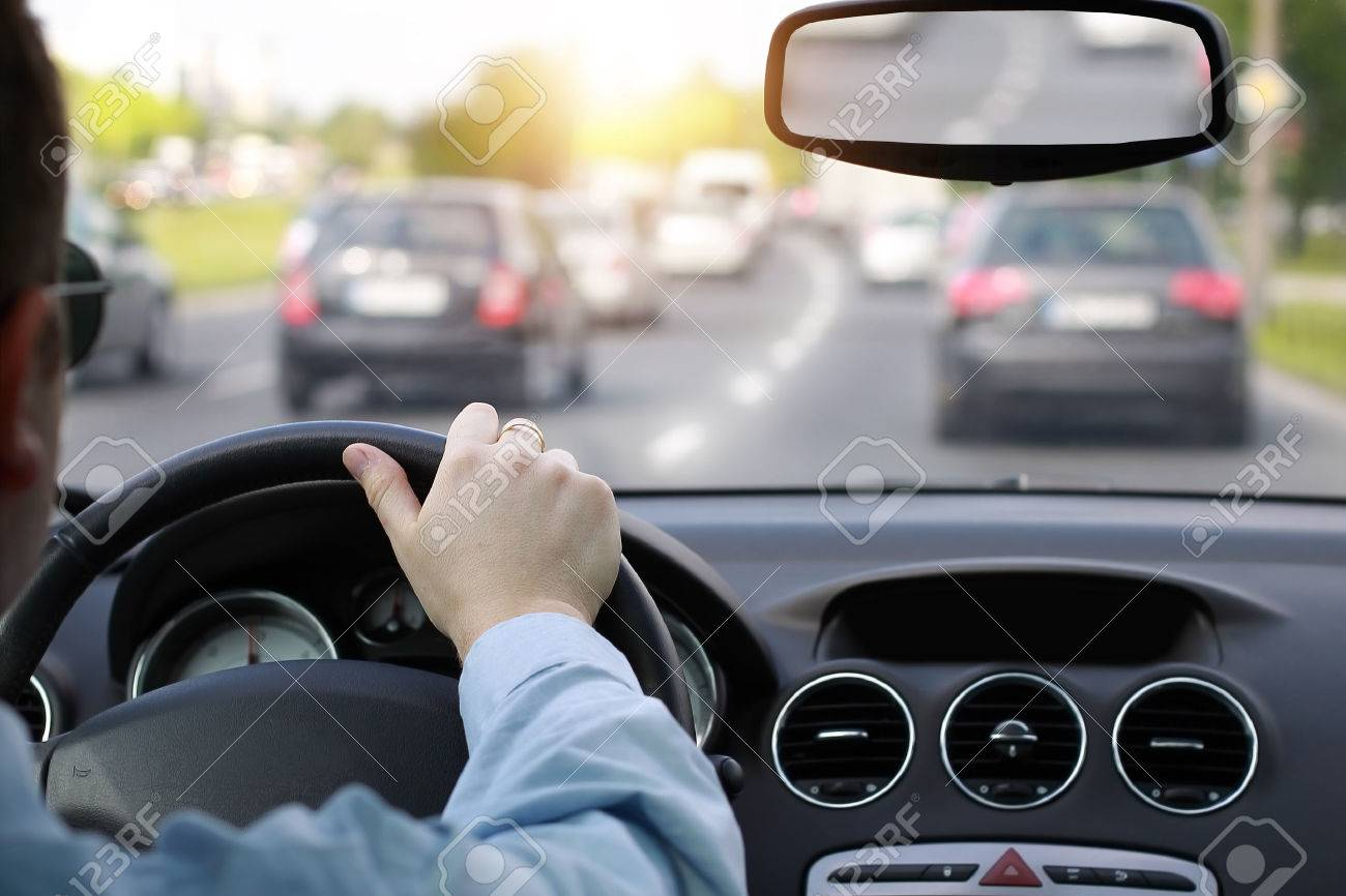 Driving a car in rush hour - 34462569