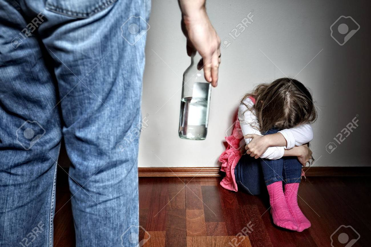 Father with belt stands above the frightened daughter - 35217953