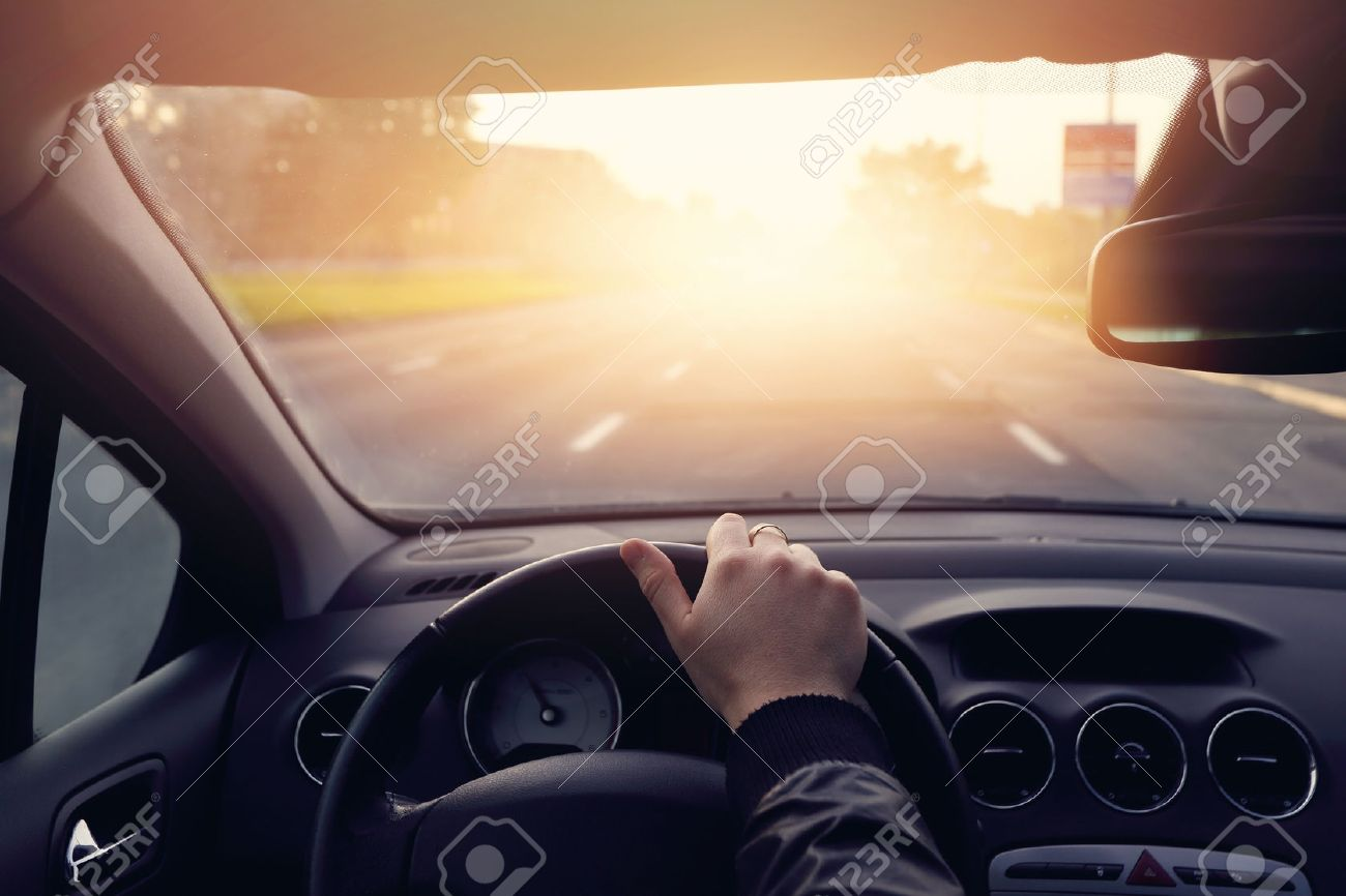 The road to success - a driver traveling on a road to the sun - 42095462
