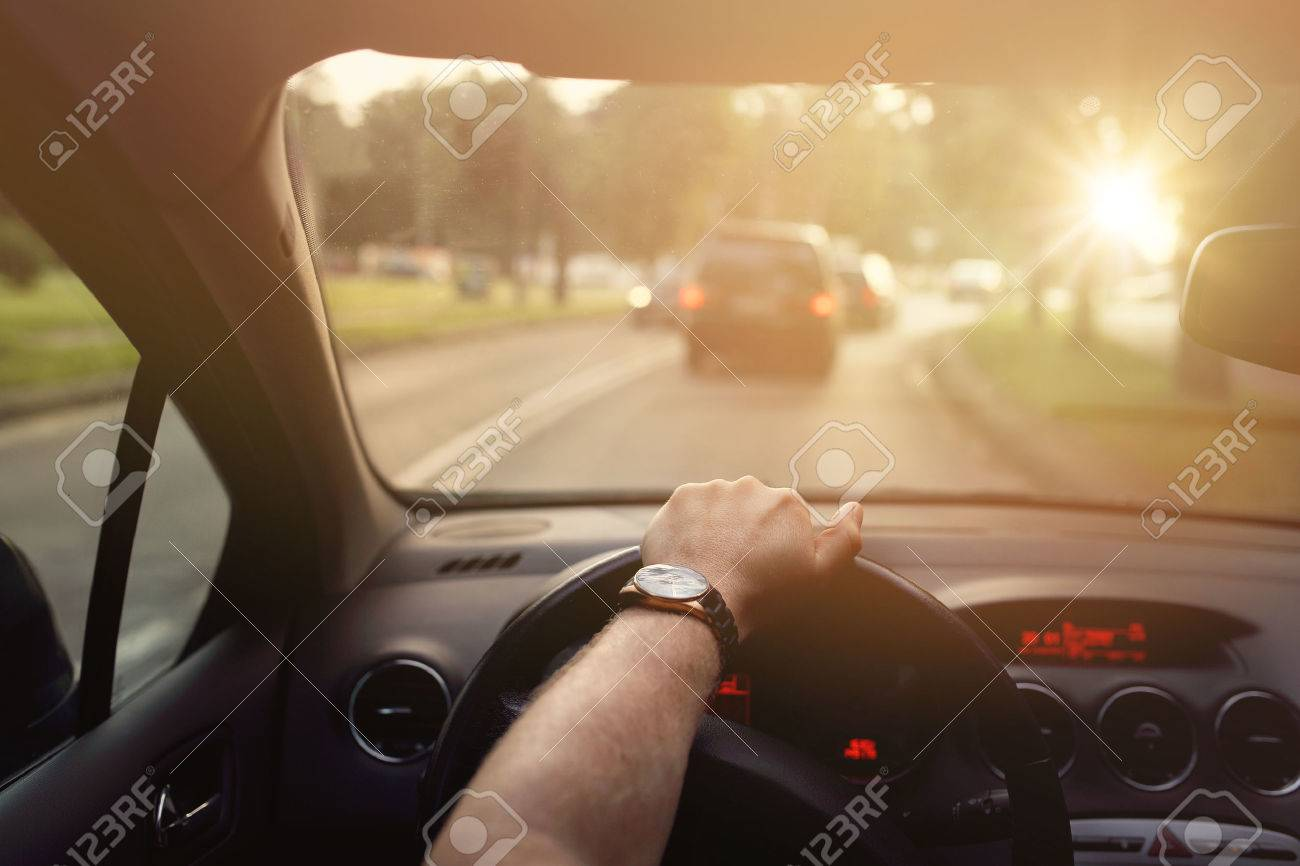 Driving down the street in car on a sunny beautiful day - 42095463