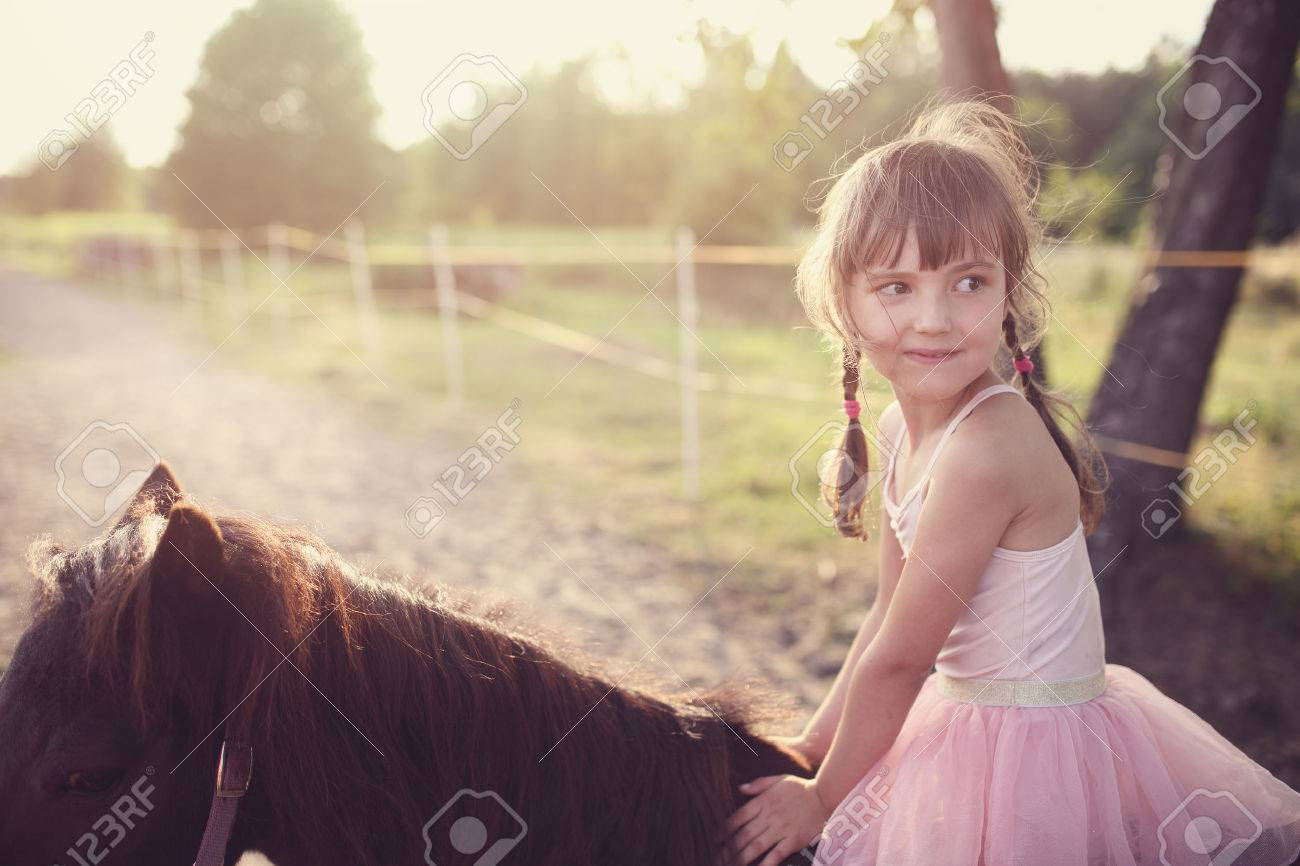 happy young girl riding horse - 42859575