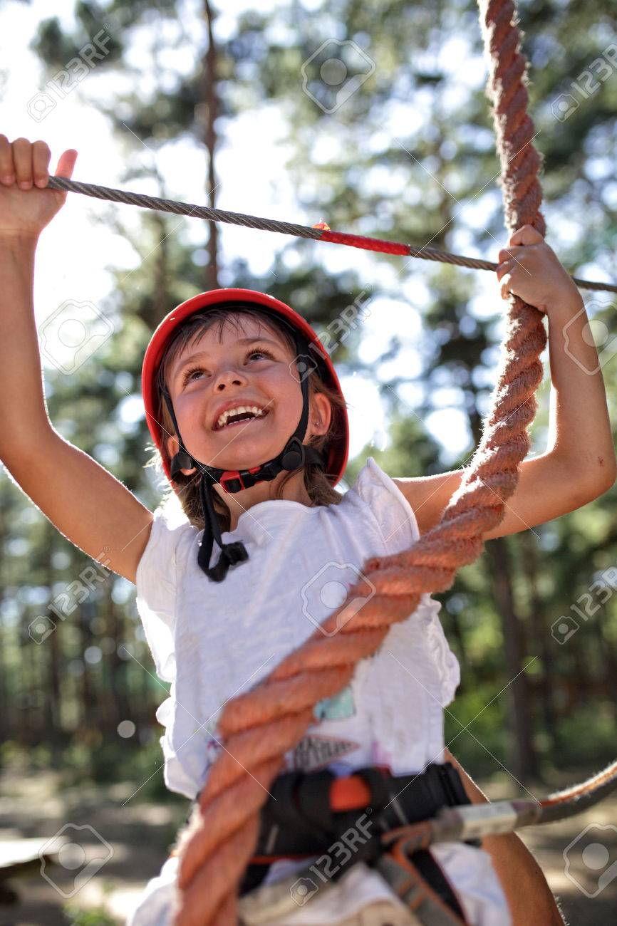 Young girl on the rope park - 44434080