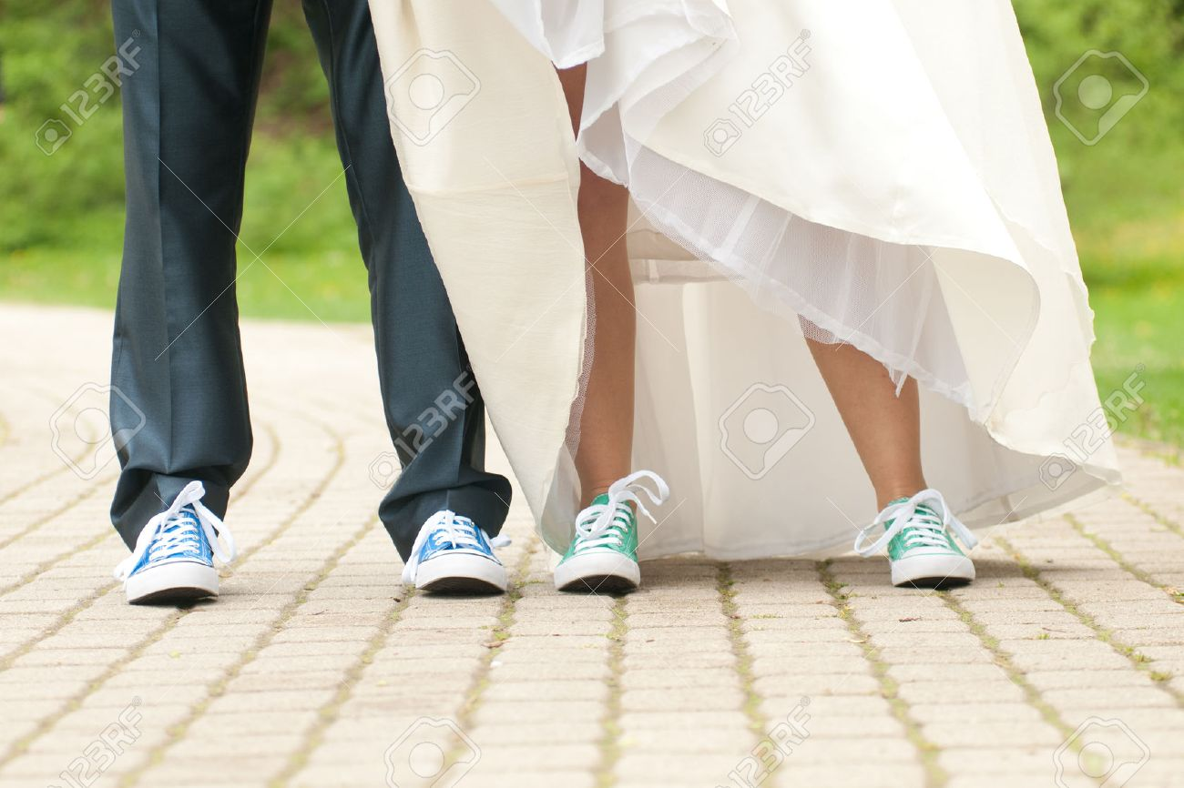 wedding sneakers bride and groom in color gym shoes stock photo