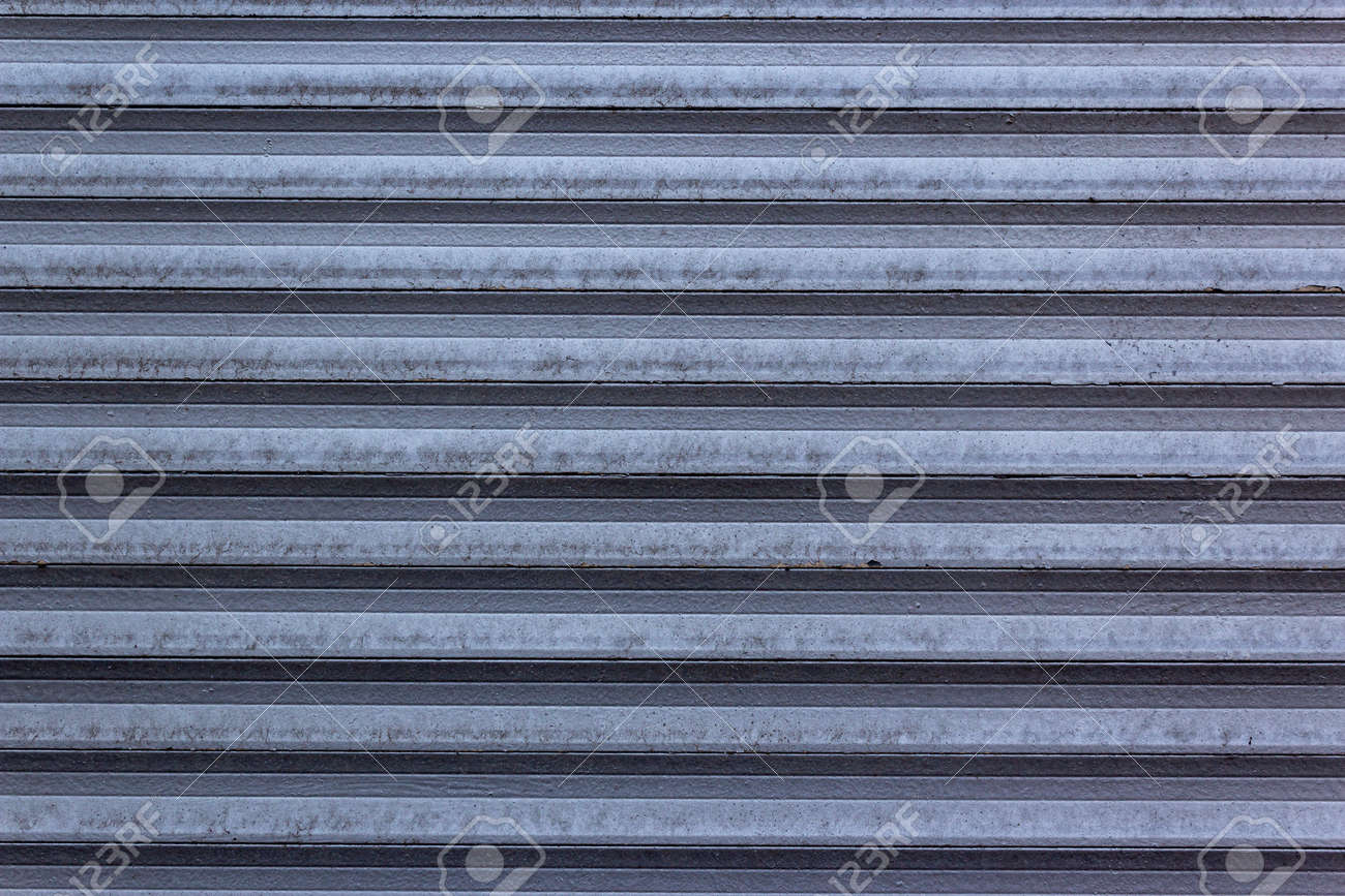 Corrugated sheet metal, badly painted with gray paint for background. Metal corrugated roofing sheet.Painting of metal surfaces for rust control Abstract background for sites and layouts. Iron fence - 167020837