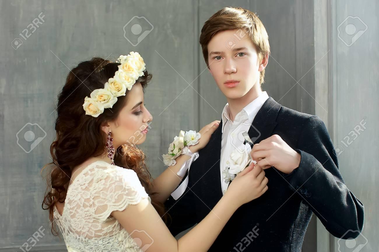Cute Teenage Prom Couple In Beautiful Interior - Girl Pinning ...