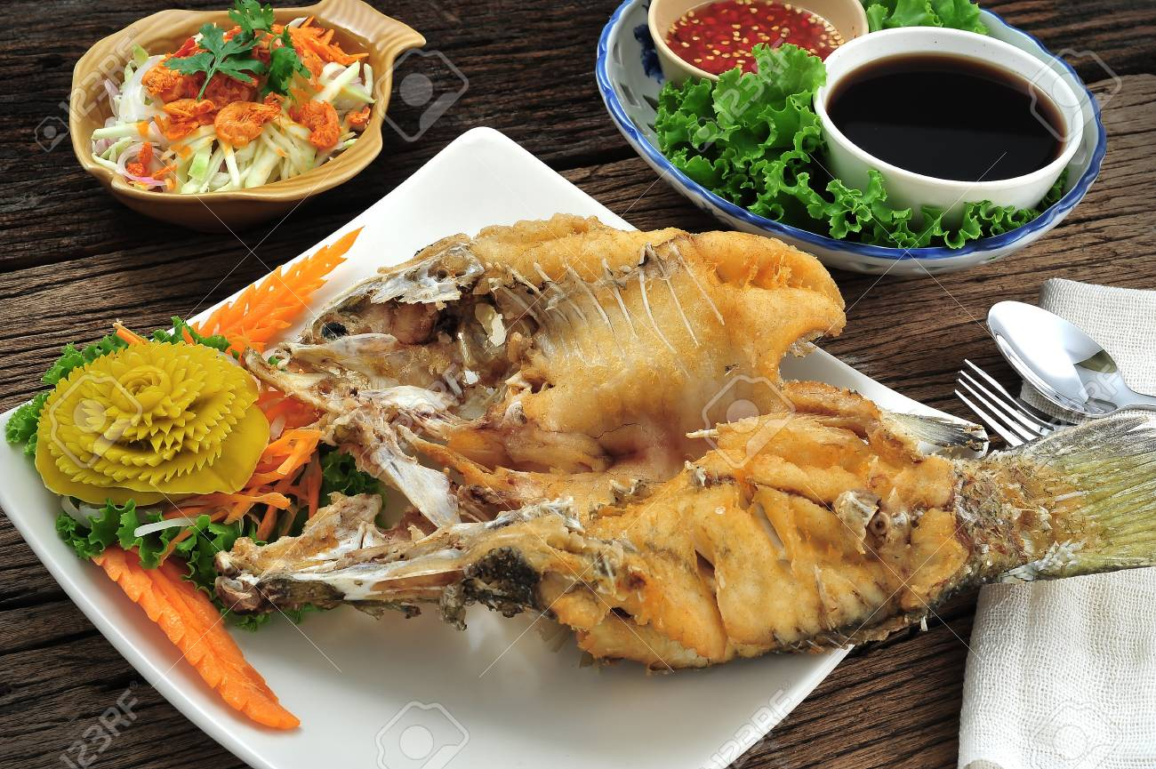 Deep fried fish with fish sauce Stock Photo - 13678644